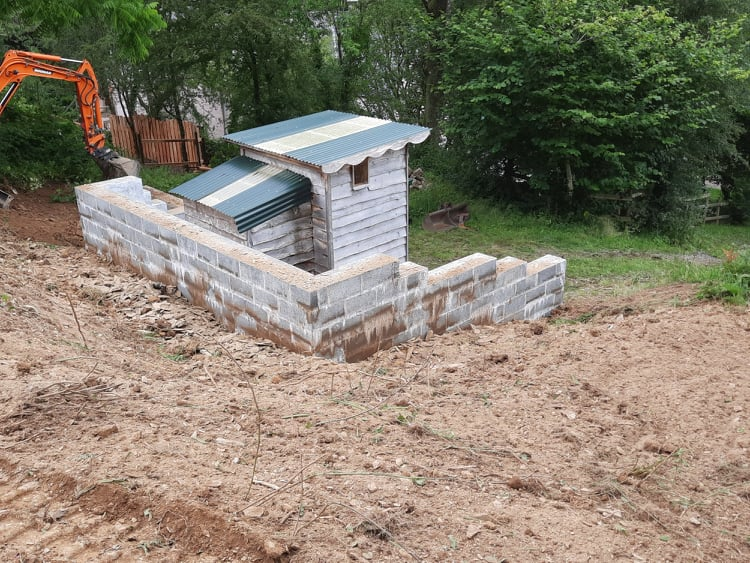 Backfilling behind the Compost Toilets